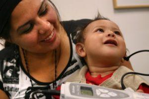 mom-baby-examining-ear